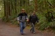 Young adults walking through wooded path