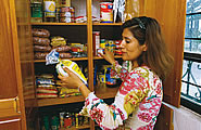 Woman looking at food storage
