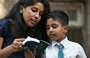 Boy and girl reading the scriptures