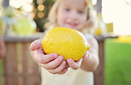 Little girl with a lemon