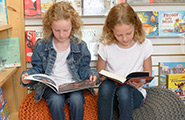 Two girls reading books
