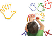 Illustration of a boy tracing his hands in crayon