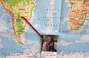 World map with picture of young girl and older woman pasted on