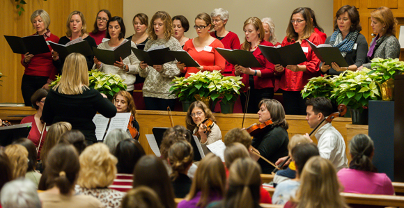 Local community Christmas choir performing a musical program