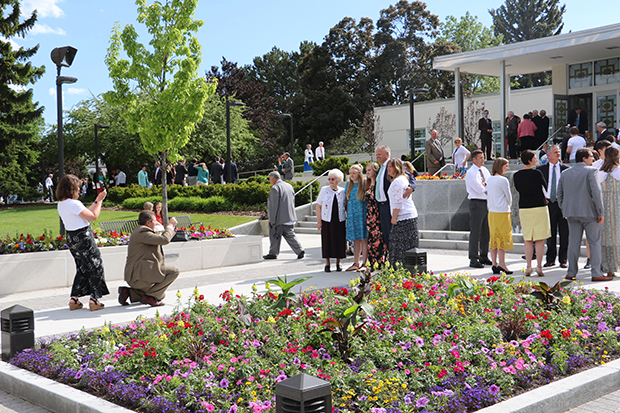Families gather for photos outside the Idaho Falls Idaho Temple on May 1, 2017, during the ongoing temple open house. Photo by Jason Swensen.