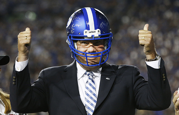 ea9613cc7 given the game ball and a BYU helmet during the Brigham Young University vs.  University of Utah football game in ...