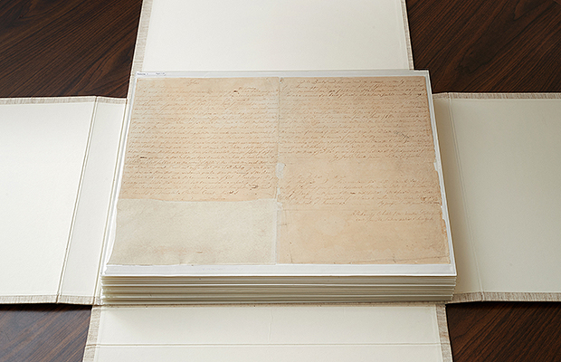 the first two pages of the printers manuscript of the book of mormon sit atop the rest of the manuscript on the casing that folds over it and then slides - Book Of Colors