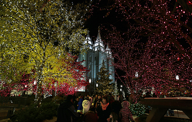Visitors enjoy the Christmas lights near Temple Square in Salt Lake City on  Friday, November 24, 2017. Photo by Ravell Call, Deseret News. - Christmas Lights On Temple Square Welcome Visitors From Near And Far