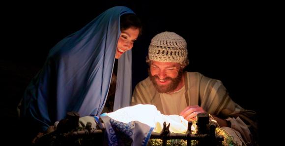 Couple recreating the nativity scene