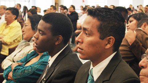 Mormon missionaries and members listen to Elder Ballard