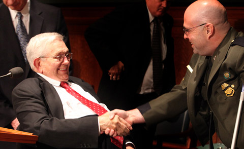 President Packer shaking hands