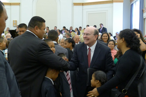 Elder Cook with members in New Zealand
