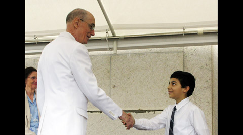 Elder Eyring shaking hands