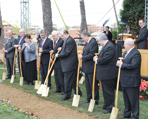 President Monson joins leaders, officials, and guests in turning over soil at the groundbreaking for the Rome Italy Temple.