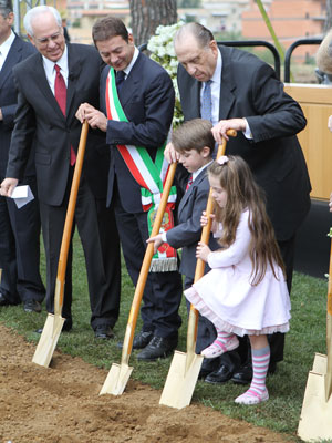 President Monson assists two children during the groundbreaking ceremony.