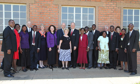 Elder Nelson with local leaders in Malawi