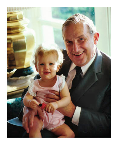 Elder Scott holding a young child