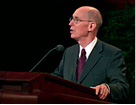 President Henry B. Eyring speaking at the pulpit.