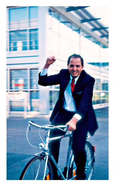 Elder Andersen on bike while mission president