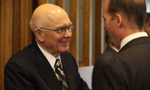Elder Oaks and a local leader