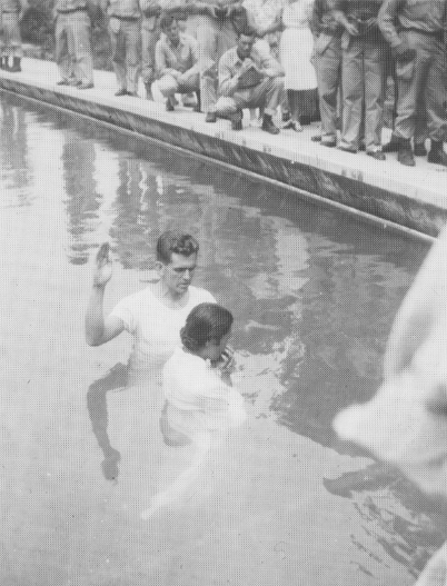 Boyd K. Packer preparing to perform a baptism in Japan after World War Two