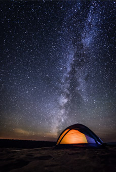 Starry night over a tent