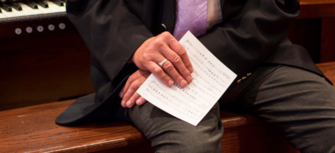 hands with sheet music