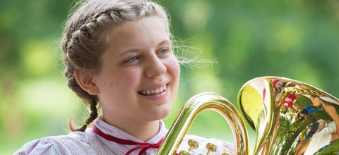 girl holding a mellophone