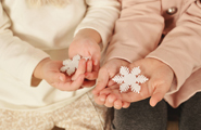 Hands holding Snowflakes