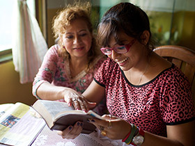 women reading the scriptures together