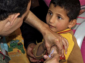 young boy receiving a shot