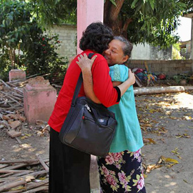 Sister Aburto hugging woman