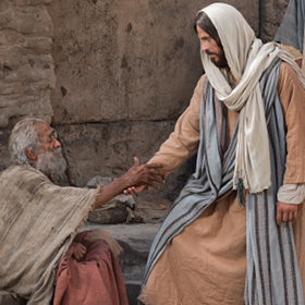 The Savior helping a man