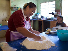 woman kneading flour