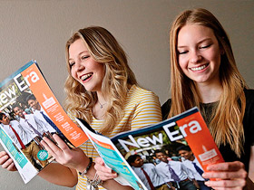 young women reading New Era magazine