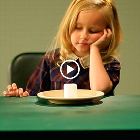 young girl looking at a marshmello