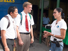 missionaries talking to a woman