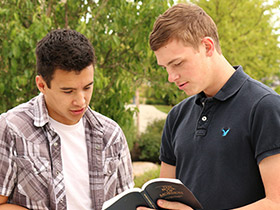 young men reading scriptures