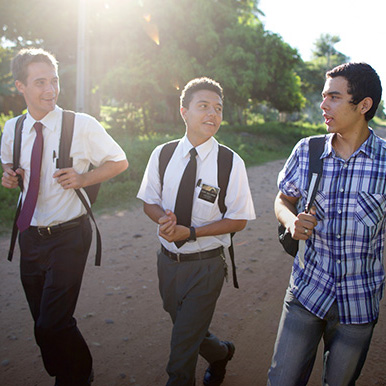 missionaries talking to a man