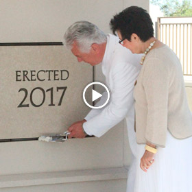 President and Sister Uchtdorf putting mortar in temple cornerstone