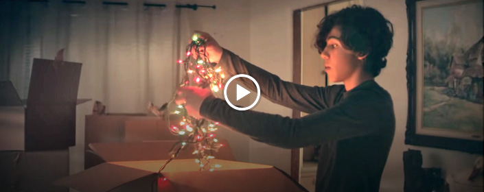 young man holding christmas lights