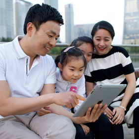 family looking at a mobile device