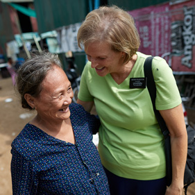 senior sister missionary talking with a woman