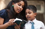 brother and sister reading scriptures