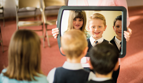 Children looking into a mirror