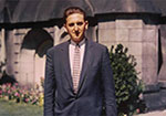 Young President Thomas S. Monson standing outside