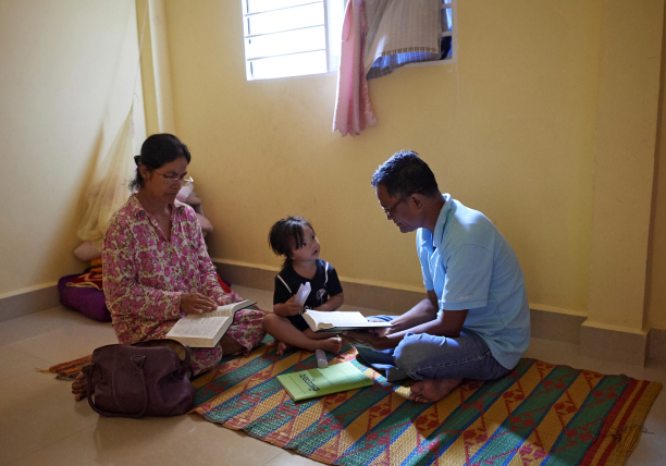 Phan Phon and family reading scriptures