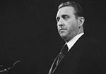 A black and white photo of President Thomas S. Monson at the pulpit.