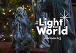 "A statue of Mary with baby Jesus with the words ""#Light the World: Mormon.org"" in white letters."