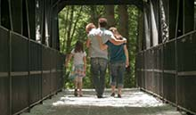 Family walking on a bridge
